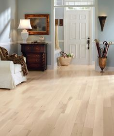 "Light hardwood floor for upstairs. ""The light pastel walls and light hardwood floor pack a creative punch when paired with the dark, dramatic furniture. The two elements also make the room look brighter and more lively. Laminate Flooring Colors, Hardwood Floor Colors, Vinyl Plank Flooring, Flooring Options, Diy Flooring, Maple Hardwood Floors, Dark Hardwood, Armstrong Flooring, Dark Furniture"