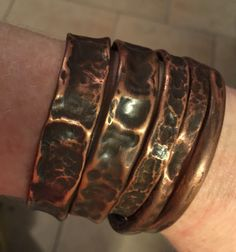 Air chased stacked copper cuffs