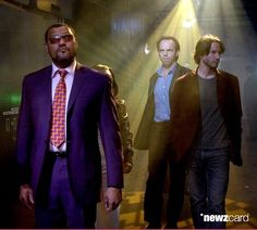 Laurence Fishburne, Hugo Weaving and Keanu Reeves during The Cast of 'The Matrix Reloaded' and P.O.D. Visit MTV's 'TRL' - May 5, 2003 at MTV Studios, Times Square in New York City, New York, United States.