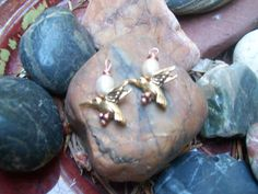 Hummingbird and cultured pearl earrings  http://www.etsy.com/shop/victorygarden41?ref=ss_profile