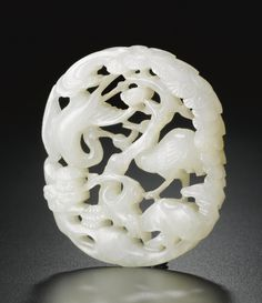 A RETICULATED WHITE JADE PENDANT  QING DYNASTY, 18TH CENTURY