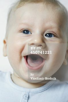 Stock Photo : A baby boy smiling and looking up