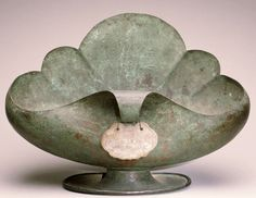 Footed copper bowl with a carved jade pendant by Marie Zimmermann, 1922.