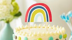 """BABY SHOWER RAINBOW CAKE TOPPERS: A """"love makes good things grow"""" baby shower theme will come to life with this rainbow cake topper."""