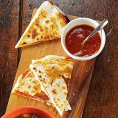 Pizza Quesadillas Recipe -When my husband and I needed a quick meal, I fixed this recipe using leftover ingredients. Unlike traditional Mexican quesadillas, it calls for Italian meats, cheeses and seasoning. Serve it with a green salad for a simple dinner for two. —Barbara Rupert, Edgefield, South Carolina