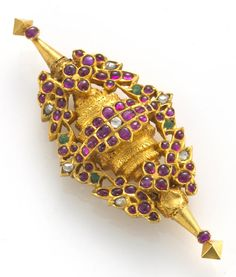 A Mughal style ruby, emerald and diamond 'marriage pendant'  mounted in heavy gold-plate; dimensions: 3 1/4 x 1 3/8in.