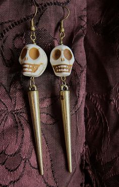 lady faye WITCHY bone skull and spike earrings by angelcake, $25.00