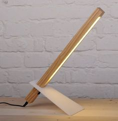 Our Handcrafted Wooden desk lamp looks more like a sculpture than a light fixture with its super thin and modern lamp design. Plus it's sliding acrylic leg for adjusting the desk lamp height. The desk lamp has 18 LEDs to make it both energy efficient and Wooden Desk Lamp, Wood Lamps, Luminaria Diy, Lampe Decoration, Brass Lamp, Pendant Lamps, Modern Desk, Modern Table, Night Lamps