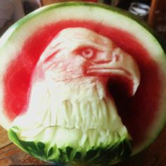 WOW. Happy 4th of July. A centerpiece watermelon carving by freehand food artist, Carl Jones. Pin for your followers. This needs to go VIRAL! :)