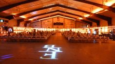 Western themed party in a hockey arena. Up lighting in sunset colors of orange and red. Duluth Event Lighting Wedding lighting, lighting décor. Wedding photography, wedding ideas.