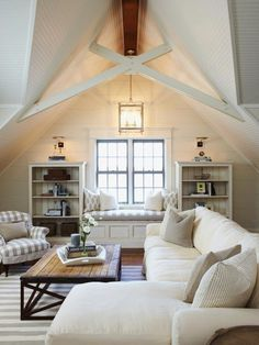 Family room with relaxed style, comfortable seating - Muskoka Living Designs..Darker color on furniture.