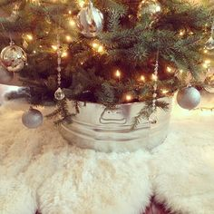 Try placing your Christmas tree stand inside of a galvanized bucket. It's such an easy and inexpensive solution to a tree skirt!