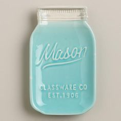 Our embossed Mason Jar Ceramic Spoon Rest captures the look of vintage blue mason jars. Use this affordable accent to protect the counter from messy utensils.
