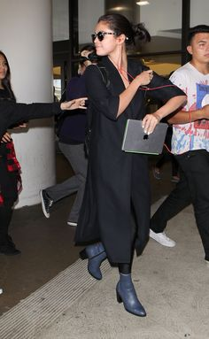 July 28: Selena arriving at LAX Airport in Los Angeles, California