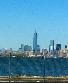NYC Freedom tower and the Statue of Liberty -taken from NJ side near port.