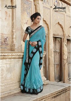 Stunning sea green Georgette cum net saree with heavy resham jari diamond work further refined by velvet border carrying satin inner and silk black blouse.