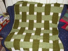 Woven Blocks, free pattern by C.L. Halvorson.  Simple two-round granny squares; it's all about the colors & layout.  Pic from Ravelry Project Gallery.  . . .  ღTrish W ~ http://www.pinterest.com/trishw/  . . .   #crochet #afghan #blanket #throw