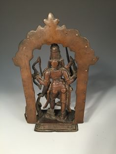 Lot 663 - An Indian bronze figure of Shiva as Virabhadra, possibly 18th century west Deccani, he stands within