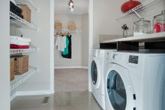 Genius!!!  The laundry room goes into the master bedroom closet.  You can put your clothes away straight out of the dryer.  Excel Homes- Manning show home, Heron Pointe at Reunion, Airdrie