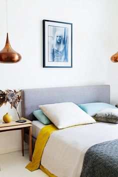 Modernist bedroom with color blocking and a dash of metallic accessories