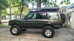 """'98 D1 Trail Pig. RockStar Fab bumpers/tire carrier/roof rack, 3"""" RTE springs, cones, 11/12"""" Fox 2.0's."""