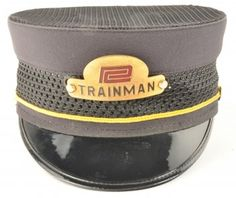 Railroad Trainman's Cap from the Penn Central with enameled hat badge. Hat has a mesh top to allow for cooler wearing in hot temperatures and is sized 7-3/8. size: 7-3/8
