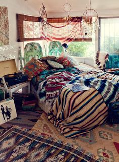 boho bedroom. love the record player and the blankets and the rugs.
