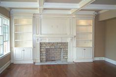 Change the fire place stone and wall color then some darker hardwood and it'd be perfect!