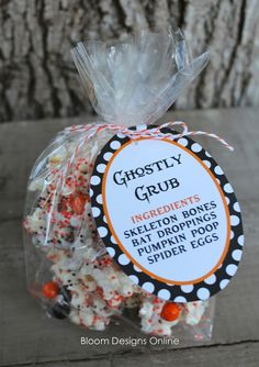 Ghostly Grub: two bags of popped popcorn & a bag of candy corn in a bowl, drizzle 1 package of white almond bark over the popcorn and candy corn, then spread out on to wax paper. Sprinkle with halloween sprinkles and let cool 15-30 minutes.