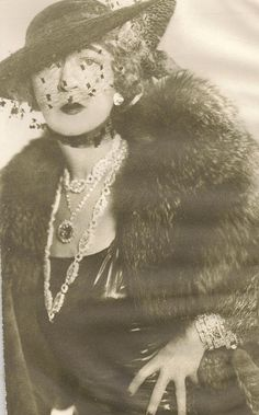 Mrs. McLean wearing her infamous hope diamond. Harry Winston acquired it in 1947 and eventually donated it to the Smithsonian. The most beautiful diamond you will ever see, with a very interesting history. I'm obsessed!