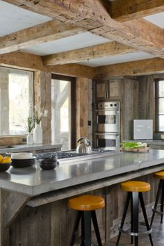 rustic beams and Kitchen cabinets, concrete countertops