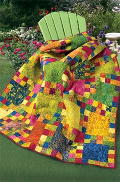 Imagine curling up with this quilt on a snowy day with a good book.