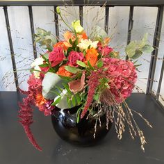 Glass bowl of cream, pink and orange flowers with silver foliages. Orange Flowers, Fresh Flowers, Bouquets, Floral Wreath, Vase, Wreaths, Seasons, Cream, Silver