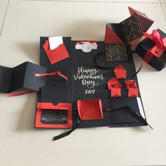 "Buy Valentine Explosion Box In Black, Red And Silver in Singapore,Singapore. ----------- Info ------------- Size: 4x4""  Explosion box card with - 1 layer - a card in envelope  - 2 tags , 1 blank and 1 with sentiment  - a squash card - a  Chat to Buy"