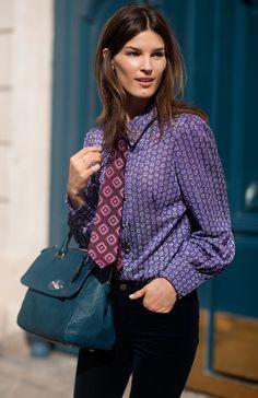 Hanneli Mustaparta in patterned menswear look.  Mulberry bag.  Miu Miu blouse?  Or maybe just the Miu Miu look...