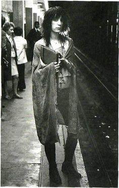 Patti Smith in Subway — Gerard Malanga, 1971  (68th Street/Lexington Ave, subway station,        New York City)