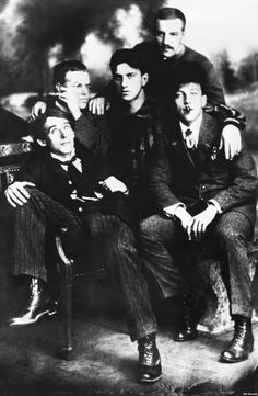 Futurist poets in Moscow in 1911. Clockwise from bottom left:  Aleksei Kruchyonykh, David Burlyuk, Vladimir Mayakovsky, Nikolai Burlyuk, and Benedikt Livshits.
