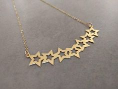 Unique stars pendant Necklace, threaded on a delicate gold-filled chain. Pendant made of 24k gold plated brass base.  Necklace length 15.7 inch 40 cm  Item will be shipped in a branded gift box. Complete the look with the matching Golden Earrings.  To view matching earrings click here: https://www.etsy.com/il-en/listing/556685821 To continue shopping, check out my Etsy store: https://www.etsy.com/shop/HilaAssaJewelry
