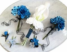 paper flower wedding package from @thecrimsonpoppy - rose toss and bridesmaids bouquets in three shades of turquoise cardstock, rosebud boutonnieres, cardstock orchid boutonnieres, wrist corsages of cardstock orchids, and realistic bouquet of hand-tinted calla lilies and white roses