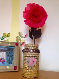 Decorated sauce jar with sisal rope, glass beads and a decopatched wooden heart. Daughter loves it as a feature piece in her bedroom.