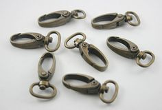 10 pcs.Zinc Antique Brass Swivel Trigger Clips by 18StudsandSpikes, $5.00