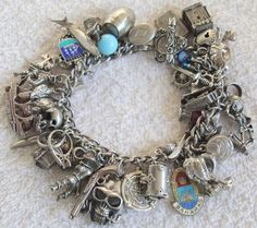 Gonna start collecting charms to make one of these for myself! Sterling Silver Pirate Charm Bracelet