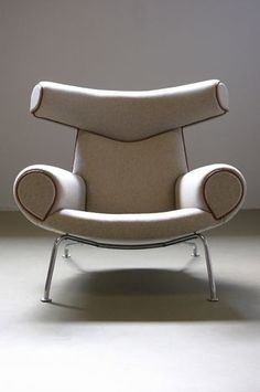 Ox Chair, 1960 by Hans Wegner (tubular steel frame, fabric and leather upholstery)