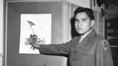 Ira Hayes pointing to his position on the flag raising picture