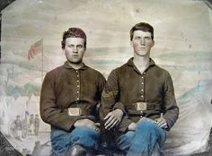 """Two Civil War soldiers in Union uniforms in front of painted backdrop showing military camp scene."" Quarter-plate tintype, hand colored. Liljenquist Family Collection of Civil War Photographs, Library of Congress."