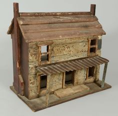 Lot 545: Folk Art Dollhouse Cabin. This lot was sold for $250 at our January 26, 2013 auction.