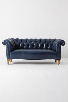 twist on the chesterfield has all the proper charms - button-tufted upholstery and the telltale scoop created by a level back and arms. Now available in sumptuous, richly hued sable or sapphire leather upholstery, which lends contemporary panache.