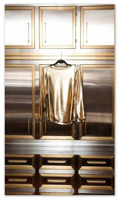 The Coveteur - closets - kelly wearstler closet, silver and gold cabinets, closet cabinets, Stunning walk-in closet featuring floor to ceil.