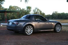 Metallic grey mx5 roadster coupe. This could be the car....