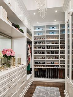 Contemporary Closet with Hardwood floors, High ceiling, Chandelier, Built-in bookshelf, can lights, Custom shoe shelving